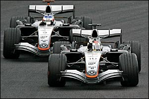 Juan Pablo Montoya wins the Brazilian Grand Prix from Kimi Raikkonen