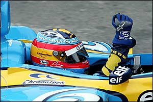 Fernando Alonso celebrates his third place finish at Interlagos