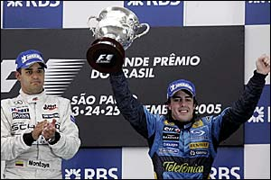 Juan Pablo Montoya (left) applauds Fernando Alonso