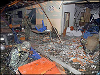 Thai soldiers inspect the damages caused by a bomb which exploded outside a hotel at Sungai Kolok in Narathiwat province, 17/2/05