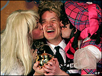 Tim Robbins receiving his award