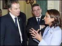 Prime Minister Tony Blair speaks to commission president Nawal El Moutawakel