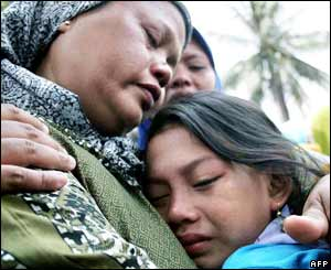Relatives of an Indonesian woman  mourn her death in Sempu Gardu village, 26 September