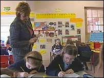 A teacher looks over her pupils' work at Newlands Primary