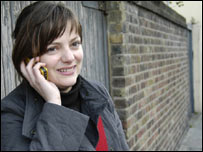 Woman using mobile phone, BBC