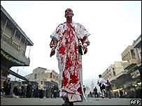 An Iraqi Shia walks alone outside Imam Mussa al-Kazem in central Baghdad after he flagellated himself to mark Ashura