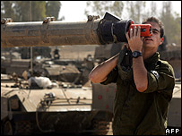 Israel troops checks the barrel of a tank