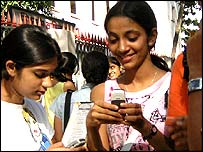 Girls using mobile phones in India
