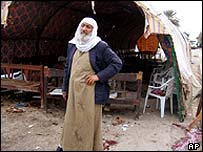 Haj Ibrahim al-Falahi stands next to the tent out up for his wife's funeral, which was the target of a suicide bomb attack in western Baghdad, 19 February 2005,