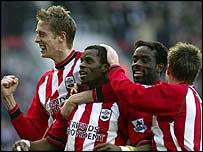 Southampton team-mates celebrate with Henri Camara