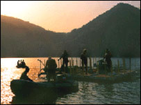 Sunset on Lake Nyos finds engineers installing the vent pipe.  Image: George Kling