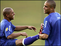 Ronaldo holds Roberto Carlos in a stretch