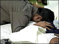 Bangladeshi man mourns his dead father