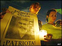 Protester carrying a poster of Filiberto Ojeda Rios at a demonstration in San Juan on Saturday