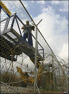 Man working on the border fence
