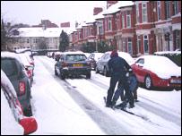 Skiers in a Newcastle street