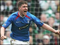 Gregory Vignal celebrates opening the scoring for Rangers