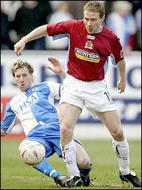 Blackburn's Andy Todd and Burnley's Ian Moore battle for possession
