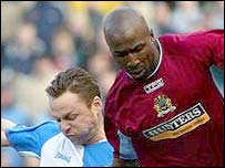 Paul Dickov and Mo Camara epitomise the intense struggle