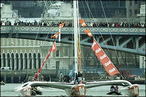 Fans line along London Bridge as Ellen's B&Q trimaran passes by