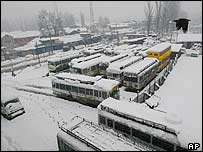 A bus station is covered with snow in Srinagar, summer capital of Kashmir