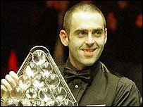 Ronnie O'Sullivan celebrates with the Masters trophy