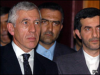 Jack Straw, surrounded by Iranian officials in London