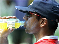 Rahul Dravid drinks a bottle of orange energy drink