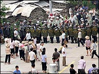 Chinese riot police block villagers at Taishi village, in southern China's Guangdong province Monday Sept. 12, 2005