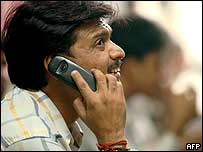 Man in India on mobile phone