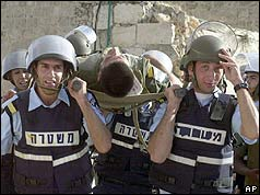 Israeli troops carrying man on stretcher