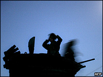 Marines from the 1st Battalion 23rd Marines prepare to leave their base in Haditha, west of Baghdad