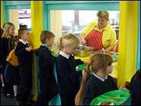 Children queue for school meals