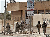 US troops secure the area in Talafar following an attack by a female suicide bomber on 28/9/05