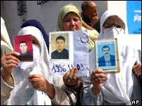 Women holding pictures of missing relatives stage protest in Algiers 