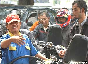 Motorists queue up to fill their tanks at a gas station in Jakarta, Indonesia, Thursday, Sept. 29, 2005.