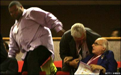 Stewards eject the 82-year-old heckler Walter Wolfgang from the Labour conference