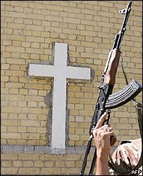 A soldier patrols outside Baghdad's Anglican Church