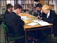 boys working in school library