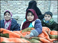 Iranian children prepare to sleep outside their homes in the village of Dahuyeh