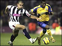Neil Clement battles with Henri Camara