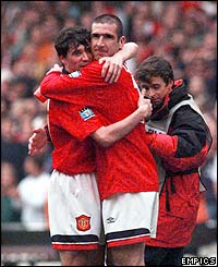 Roy Kean embraces Eric Cantona after beating Liverpool in the 1996 FA Cup final