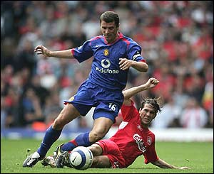Roy Keane is tackled by Liverpool's Luis Garcia