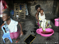 A mother bathes her child in Kinshasa, Democratic Republic of Congo