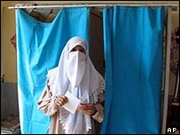 Algerian woman in traditional dress casts her vote in Sidi Rais near Algiers