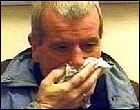 Image of a man sneezing