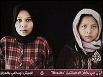 Indonesian hostages Rosidah binti Anan, left, and Rafikan binti Aming