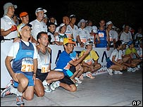 Spartathlon runners pose for photos before setting off
