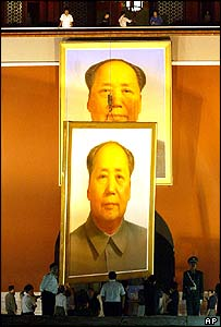The giant portrait of the late Chinese leader Mao Zedong is changed on Tiananmen Gate in Beijing