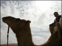 Image of boy on a camel